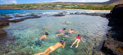 kids snorkeling in crystal clear tidepools